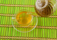 Green tea pouring Royalty Free Stock Image
