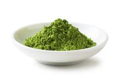Green Tea. Powder on the plate stock photo