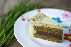 Green tea  and red nut cake Royalty Free Stock Images