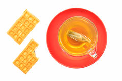 Green tea on the red plate and two waffles Royalty Free Stock Images