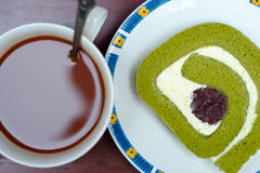 Green tea roll cake and hot cocoa Royalty Free Stock Photography