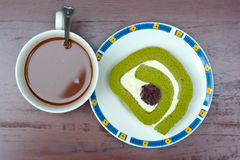 Green tea roll cake and hot cocoa Royalty Free Stock Photos
