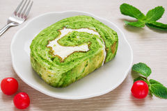 Green tea roll cake on plate Stock Images