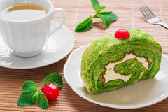 Green tea roll cake and tea cup Royalty Free Stock Photos