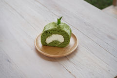 Green tea roll. On wooden dish Royalty Free Stock Photography