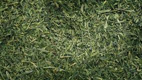 Green Tea Rotating. Overhead shot of dried green tea leaves rotating stock footage