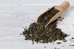Green tea with scoop on wooden background Royalty Free Stock Photography