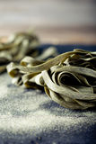 Green tea and sea weed pasta on a stone plate Royalty Free Stock Photography
