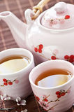 Green tea set. With teapot and cups Royalty Free Stock Photos