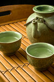 Green tea set. Jade green asian style tea set on a bamboo tray Royalty Free Stock Photography