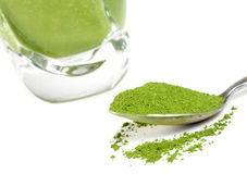 Matcha. Green tea smoothie and matcha. Focus is on the matcha Royalty Free Stock Photography