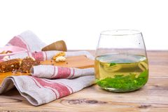 Green Tea with Some Nuts. On wooden table Royalty Free Stock Photo