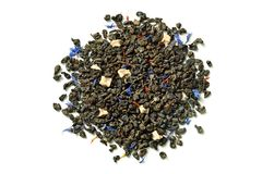 Green tea with soursop, safflower petals and knapweed on white background. Close up. High resolution royalty free stock photography