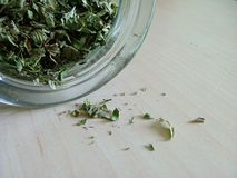 Green tea spilling out stock photos