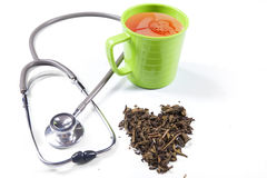 Green tea and stethoscope Stock Photos