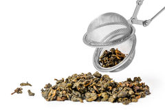 Green tea and strainer Royalty Free Stock Image