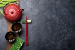 Green tea and sushi chopsticks royalty free stock photography