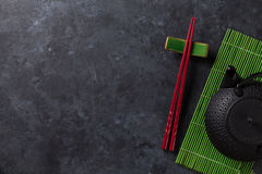 Green tea and sushi chopsticks Stock Photography