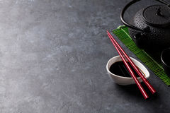 Green tea and sushi chopsticks Royalty Free Stock Photos