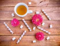 Green tea, sweets and flowers Royalty Free Stock Photography