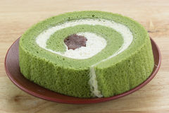 Green Tea Swiss Roll Cake. On the plate royalty free stock photo