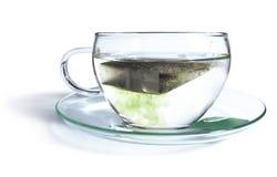 Green tea with tea bag Stock Images