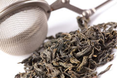 Green tea and tea strainer Royalty Free Stock Image