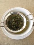 Green tea in tea strainer Royalty Free Stock Photo