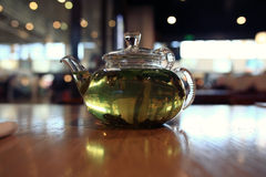 Green tea in a  teapot Royalty Free Stock Image