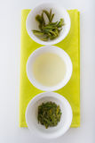 Green tea in three forms: dry, infusion and leaves after brewing Stock Images
