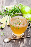 Green tea with thyme and lime on rustic wooden background Stock Images