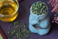 Green tea ti kuan yin. Turquoise Tea Tee Kuan Yin tea is brewed and dry Stock Photo