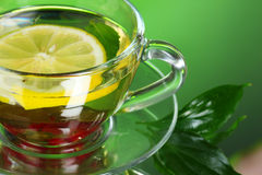 Green tea in transparent cup with lime Royalty Free Stock Images