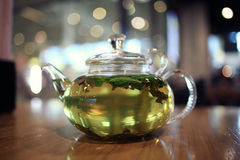 Green tea at transparent teapot Stock Image