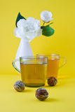 Green tea and vase with a white flower Stock Photography