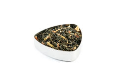 Green tea. Vietnam jasmine, a vietnamese green tea with jasmine petals, in a metal container Royalty Free Stock Photo