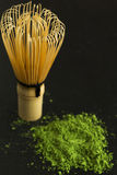 Green tea and whisk Stock Image