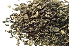 Green tea on white background. Top view. Close up. High resolution royalty free stock photo