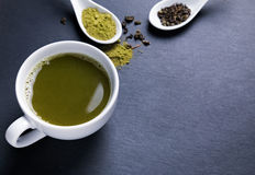 Green tea in a white cup on the black background Stock Images
