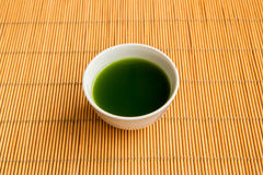 Green tea in a white cup Stock Image