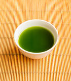 Green tea in a white cup. Royalty Free Stock Photo
