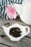 Green tea, white teapot Stock Images