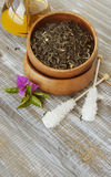 Green tea in a wooden bowl with flowers Royalty Free Stock Photo