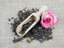 Green tea and wooden shovel on linen background Stock Photography