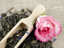 Green tea and wooden shovel on linen background Royalty Free Stock Photos
