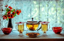 Green Tea and Yellow flowers Royalty Free Stock Photography