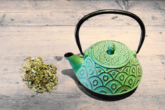 Green teacup and tea herb royalty free stock images