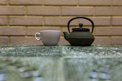 Green teapot and cup in a resuatrant Royalty Free Stock Photo