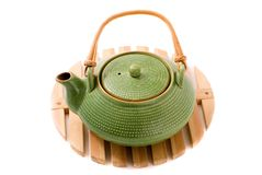 Green teapot on stand Stock Photo