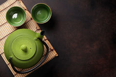 Green teapot and tea cups Stock Images